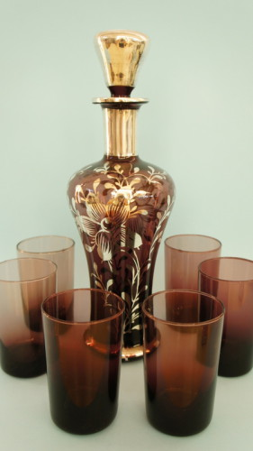 Venetian decanter with modern tumblers