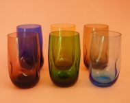 Set of coloured dimpled drinking glasses