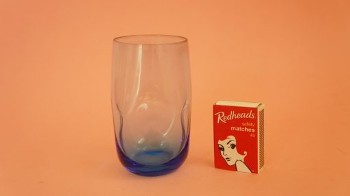 Dimpled drinking glass with matchbox